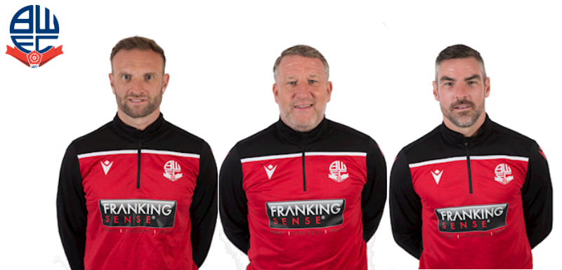Bolton Wanderers management team in training kit